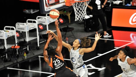 <p>               Connecticut Sun's Alyssa Thomas (25) shoots under pressure from Minnesota Lynx's Mikiah Herbert Harrigan during the first half of a WNBA basketball game Saturday, Aug. 1, 2020, in Bradenton, Fla. (AP Photo/Steve Nesius)             </p>