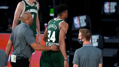 <p>               Milwaukee Bucks' Giannis Antetokounmpo (34) heads to the locker room after being ejected during the first half of an NBA basketball game against the Washington Wizards, Tuesday, Aug. 11, 2020, in Lake Buena Vista, Fla. (AP Photo/Ashley Landis, Pool)             </p>