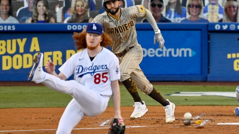 <p>               Los Angeles Dodgers starting pitcher Dustin May, left, avoids getting hit by a comeback shot hit by San Diego Padres' Eric Hosmer during the second inning of a baseball game Monday, Aug. 10, 2020, in Los Angeles. (AP Photo/Mark J. Terrill)             </p>