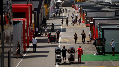 <p>               People walk through the paddocks before the Formula One Grand Prix at the Barcelona Catalunya racetrack in Montmelo, Spain, Thursday, Aug. 13, 2020. (AP Photo/Emilio Morenatti)             </p>