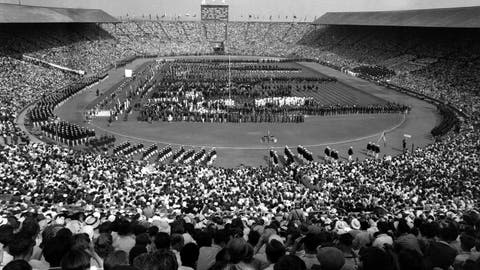 <p>               FILE - This July 29, 1948 file photo, showing the opening ceremony of the 1948 Olympic Games at Wembley Stadium, in London, England. London was still cleaning up bombing damage from World War II when it staged the Olympics in 1948. Britain was also struggling financially; food, clothing and gas were still being rationed. The athletes had to bring their own towels and, with housing in short supply, were accommodated in schools and Royal Air Force camps. The games were organized in less than two years, and despite the tiny budget it was a success, its legacies including greater sporting opportunities for women. (AP Photo, File )             </p>