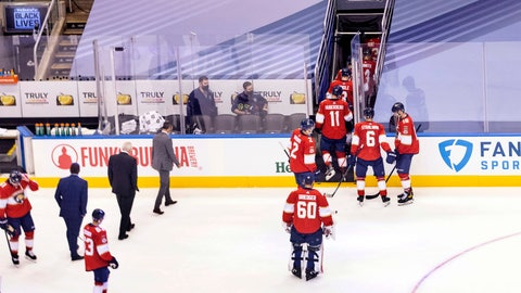 <p>               The Florida Panthers skate off the ice after their team's 5-1 loss to the New York Islanders in an NHL Stanley Cup Playoff qualifying round hockey game in Toronto, Friday, Aug. 7, 2020. (Chris Young/The Canadian Press via AP)             </p>