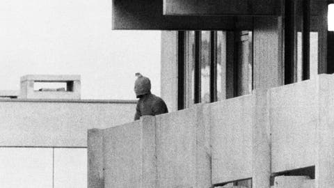 <p>               FILE - On Sept. 5, 1972, a Palestinian commando group seizes the Israeli Olympic team quarters at the Olympic Village in Munich, Germany. A member of the commando group is seen here as he appears with a hood over his face on the balcony of the building, where they hold several Israeli athletes hostage. (AP Photo/Kur Stumpf, File)             </p>