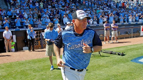 <p>               FILE - In this May 26, 2013, file photo, North Carolina head coach Mike Fox takes the field to accept the championship trophy following UNC's 4-1 win over Virginia Tech in an Atlantic Coast Conference NCAA college baseball game in Durham, N.C. UNC announced Friday, Aug. 7 2020, that Fox would retire after 22 seasons at his alma mater that included seven trips to the College World Series. Longtime assistant Scott Forbes is taking over the program. (AP Photo/Karl B DeBlaker, File)             </p>