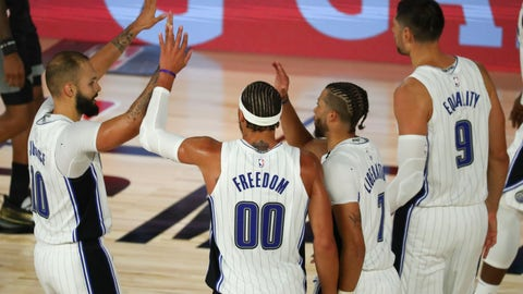 <p>               Orlando Magic guard Evan Fournier (10), forward Aaron Gordon (00), guard Michael Carter-Williams (7) and center Nikola Vucevic (9) celebrate in the second half of an NBA basketball game against the Sacramento Kings, Sunday, Aug. 2, 2020, in Lake Buena Vista, Fla. (Kim Klement/Pool Photo via AP)             </p>