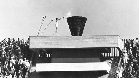 <p>               FILE - In this Oct. 10, 1964 file photo, Japanese runner Yoshinori Sakai lights the Olympic cauldron during the opening ceremony of the 1964 Summer Olympics in Tokyo. Sakai was born in Hiroshima on Aug. 6, 1945, the day the nuclear weapon destroyed that city. He symbolized the rebirth of Japan after the Second World War as he opened the 1964 Tokyo Games. Sakai was born in Hiroshima on Aug. 6, 1945, the day the United States dropped an atomic bomb on the city.  Just over 19 years later, he ran with the Olympic flame into the national stadium, left the cinder track, and jogged up a long flight of flower-lined stairs to reach the top.  (AP Photo/File)             </p>