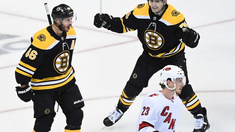 <p>               Boston Bruins center David Krejci (46) celebrates with teammate Jake DeBrusk (74) as Carolina Hurricanes left wing Brock McGinn (23) skates past during the third period of an NHL Eastern Conference Stanley Cup hockey playoff game in Toronto, Wednesday, Aug. 12, 2020. (Nathan Denette/The Canadian Press via AP)             </p>
