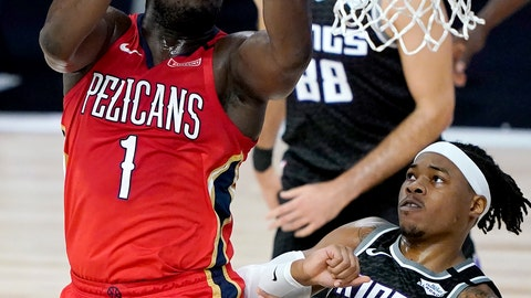 <p>               New Orleans Pelicans' Zion Williamson (1) goes up for a shot against Sacramento Kings' Richaun Holmes (22) during the first half of an NBA basketball game Thursday, Aug. 6, 2020 in Lake Buena Vista, Fla. (AP Photo/Ashley Landis, Pool)             </p>
