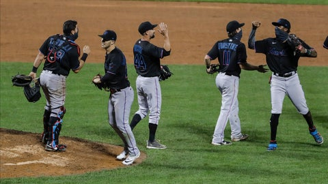 <p>               Miami Marlins' Francisco Cervelli (29) Nick Vincent (44) and Logan Forsythe (11) celebrate with teammates after a baseball game against the New York Mets Friday, Aug. 7, 2020, in New York. The Marlins won 4-3. (AP Photo/Frank Franklin II)             </p>