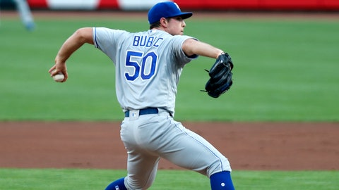 Aug 11, 2020; Cincinnati, Ohio, USA; Kansas City Royals starting pitcher Kris Bubic (50) throws against the Cincinnati Reds during the first inning at Great American Ball Park. Mandatory Credit: David Kohl-USA TODAY Sports