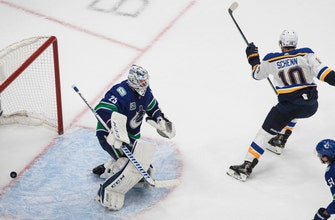 Schenn's overtime goal lifts Blues to first playoff victory, 3-2 over Canucks