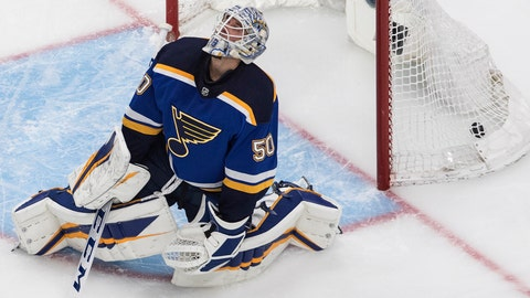 St. Louis Blues goalie Jordan Binnington reacts after giving up a goal to the Vancouver Canucks during the third period in Game 1 of an NHL hockey Stanley Cup first-round playoff series, Wednesday, Aug. 12, 2020, in Edmonton, Alberta. (Jason Franson/The Canadian Press via AP)
