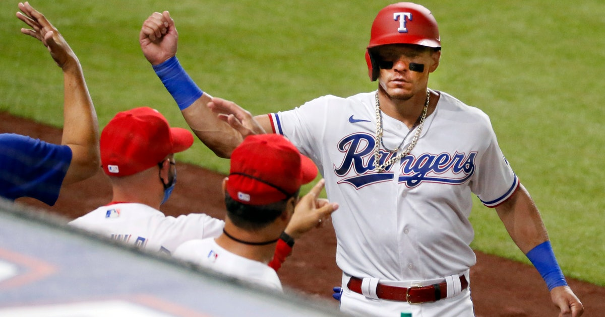 Dietrich debuts as Rangers rally in 8th for 7-4 win over M's