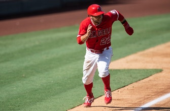 Angels use seven-run fourth inning to blow by Rangers 8-5