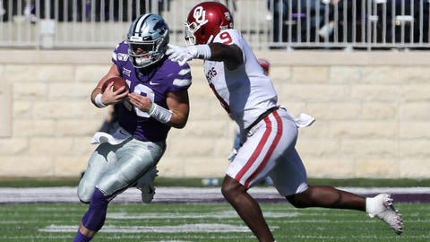 Oct 26, 2019; Manhattan, KS, USA; Kansas State Wildcats quarterback Skylar Thompson (10) is tackled by Oklahoma Sooners linebacker Kenneth Murray (9) during the fourth quarter of a game at Bill Snyder Family Stadium. Mandatory Credit: Scott Sewell-USA TODAY Sports