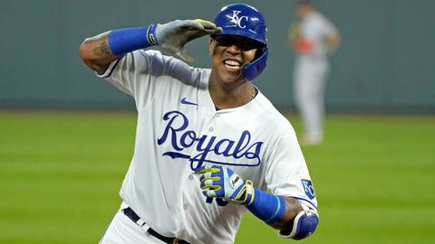 Kansas City Royals' Salvador Perez celebrates as he runs the bases after hitting a three-run home run during the first inning of the team's baseball game against the Detroit Tigers on Thursday, Sept. 24, 2020, in Kansas City, Mo. (AP Photo/Charlie Riedel)