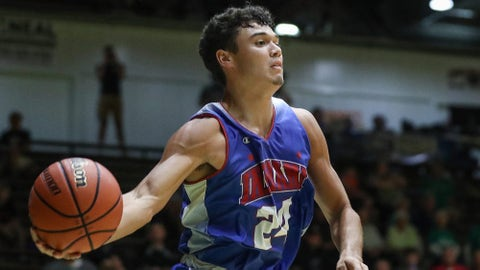 Bloomington South junior Anthony Leal (24) keeps the ball from going out of bounds under the basket in the second half of boys Indiana All-Stars versus Junior All-Stars at New Castle High School in New Castle, Ind., on Wednesday, June 5, 2019.  Indiana Junior Versus Senior Boys And Girls All Stars June 5 2019 In New Castle