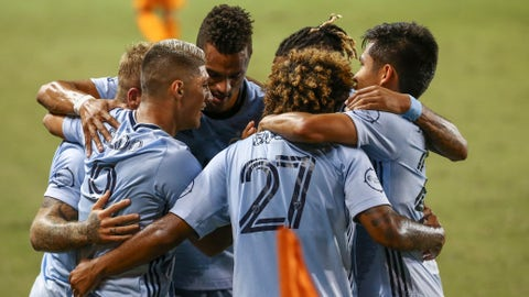 Oct 3, 2020; Houston, Texas, USA; Sporting Kansas City forward Alan Pulido (9) celebrates with teammates after scoring a goal during the first half against the Houston Dynamo at BBVA Stadium. Mandatory Credit: Troy Taormina-USA TODAY Sports