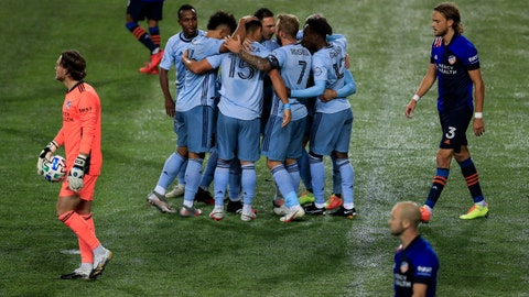 Oct 28, 2020; Cincinnati, OH, USA; Sporting Kansas City midfielder Roger Espinoza (15) celebrates with teammates after scoring a goal against FC Cincinnati in the second half at Nippert Stadium. Mandatory Credit: Aaron Doster-USA TODAY Sports