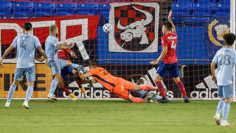 Oct 14, 2020; Dallas, Texas, USA; Sporting Kansas City forward Johnny Russell (7) appears to have scored a goal but was waved off after Sporting Kansas City forward Alan Pulido (9) interferes with FC Dallas goalkeeper Jimmy Maurer (20) at Toyota Stadium. Mandatory Credit: Andrew Dieb-USA TODAY Sports