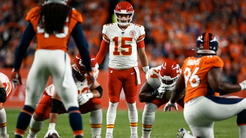 Oct 17, 2019; Denver, CO, USA; Kansas City Chiefs quarterback Patrick Mahomes (15) at the line of scrimmage in the first quarter against the Denver Broncos at Empower Field at Mile High. Mandatory Credit: Isaiah J. Downing-USA TODAY Sports