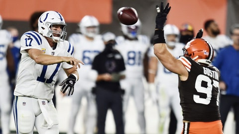 Oct 11, 2020; Cleveland, Ohio, USA; Indianapolis Colts quarterback Philip Rivers (17) throws a pass over the defense of Cleveland Browns defensive end Porter Gustin (97) during the second half at FirstEnergy Stadium. Mandatory Credit: Ken Blaze-USA TODAY Sports