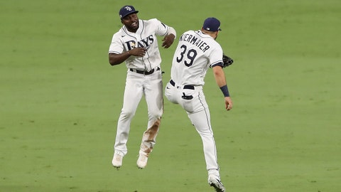 SAN DIEGO, CALIFORNIA - OCTOBER 17: Kevin Kiermaier #39 and Randy Arozarena #56 of the Tampa Bay Rays celebrate a 4-2 win against the Houston Astros to win the American League Championship Series at PETCO Park on October 17, 2020 in San Diego, California. (Photo by Sean M. Haffey/Getty Images)