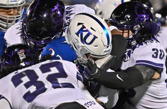 Kansas struggles to contain TCU's running game in 59-23 loss