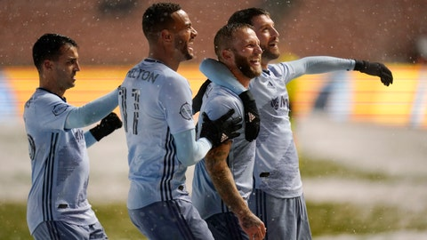 Sporting Kansas City's Johnny Russell, second from the right, celebrates after scoring against Real Salt Lake with teammates in the first half during an MLS soccer match Sunday, Nov. 8, 2020, in Sandy, Utah. (AP Photo/Rick Bowmer)