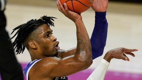 Kansas State guard Selton Miguel shoots over Iowa State guard Jalen Coleman-Lands during the first half of an NCAA college basketball game, Tuesday, Dec. 15, 2020, in Ames, Iowa. (AP Photo/Charlie Neibergall)
