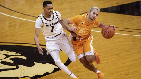 Tennessee's Santiago Vescovi, right, collides with Missouri's Xavier Pinson, left, as he brings the ball up court during the first half of an NCAA college basketball game Wednesday, Dec. 30, 2020, in Columbia, Mo. (AP Photo/L.G. Patterson)