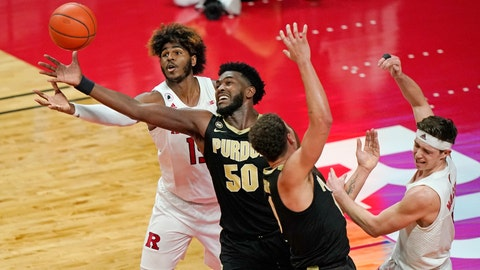 Rutgers center Myles Johnson (15) and Purdue forward Trevion Williams (50) go after a loose ball beneath Rutgers basket during the second half of an NCAA college basketball game Tuesday, Dec. 29, 2020, in Piscataway, N.J. Rutgers won 81-76. (AP Photo/Kathy Willens)