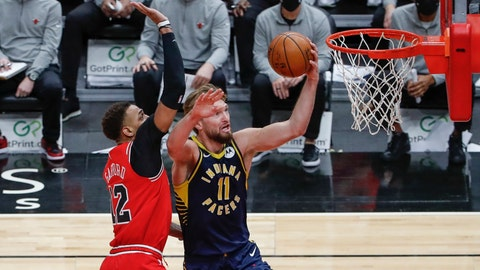 Dec 26, 2020; Chicago, Illinois, USA; Indiana Pacers forward Domantas Sabonis (11) goes to the basket against Chicago Bulls forward Daniel Gafford (12) during the second half of an NBA game at United Center. Mandatory Credit: Kamil Krzaczynski-USA TODAY Sports