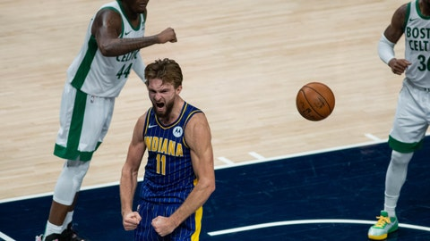 Dec 27, 2020; Indianapolis, Indiana, USA; Indiana Pacers forward Domantas Sabonis (11) celebrates his game winning shot and and one in the fourth quarter against the Boston Celtics at Bankers Life Fieldhouse. Mandatory Credit: Trevor Ruszkowski-USA TODAY Sports