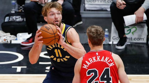 Dec 26, 2020; Chicago, Illinois, USA; Indiana Pacers forward Domantas Sabonis (11) looks to shoot against Chicago Bulls forward Lauri Markkanen (24) during the second half of an NBA game at United Center. Mandatory Credit: Kamil Krzaczynski-USA TODAY Sports