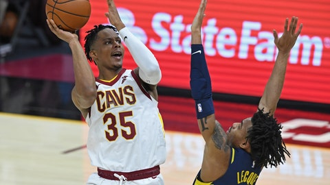 Dec 14, 2020; Cleveland, Ohio, USA; Cleveland Cavaliers forward Isaac Okoro (35) shoots over Indiana Pacers guard Jalen Lecque (0) during the fourth quarter at Rocket Mortgage FieldHouse. Mandatory Credit: David Dermer-USA TODAY Sports
