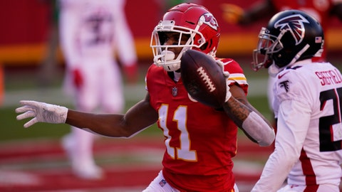 Kansas City Chiefs wide receiver Demarcus Robinson holds up the ball after catching a 25-yard touchdown during the second half of an NFL football game against the Atlanta Falcons, Sunday, Dec. 27, 2020, in Kansas City. (AP Photo/Jeff Roberson)