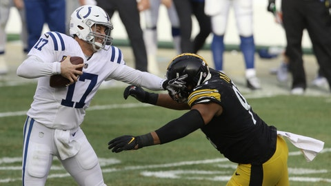 Dec 27, 2020; Pittsburgh, Pennsylvania, USA; Indianapolis Colts quarterback Philip Rivers (17) is pressured by Pittsburgh Steelers defensive end Stephon Tuitt (91) during the third quarter at Heinz Field. Mandatory Credit: Charles LeClaire-USA TODAY Sports