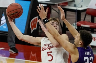 Wahl leads No 10 Badgers to 68-52 win over Northwestern