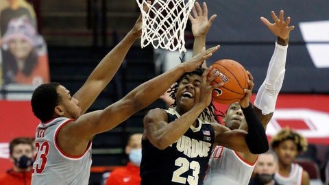 Purdue guard Jaden Ivey, center, goes up for a shot between Ohio State forward Zed Key, left, and guard Eugene Brown during the first half of an NCAA college basketball game in Columbus, Ohio, Tuesday, Jan. 19, 2021. (AP Photo/Paul Vernon)