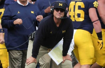 Michigan signs Jim Harbaugh to new five-year deal
