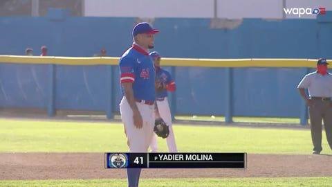 Yadier Molina pitches in a Puerto Rican winter league game.