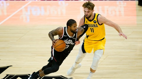 Indiana Pacers forward Domantas Sabonis (11) defends against Los Angeles Clippers guard Paul George (13) during the third quarter of an NBA basketball game, Sunday, Jan. 17, 2021, in Los Angeles. (AP Photo/Ashley Landis)