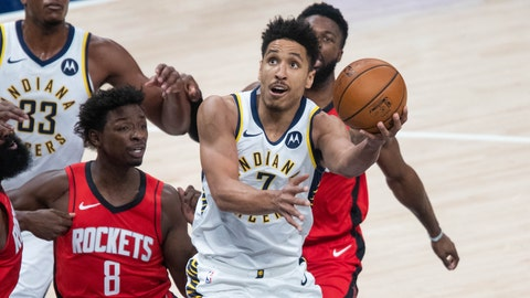 Jan 6, 2021; Indianapolis, Indiana, USA; Indiana Pacers guard Malcolm Brogdon (7) shoots the ball while Houston Rockets forward Jae'Sean Tate (8) defends  in the first quarter at Bankers Life Fieldhouse. Mandatory Credit: Trevor Ruszkowski-USA TODAY Sports