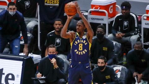 Dec 26, 2020; Chicago, Illinois, USA; Indiana Pacers guard Justin Holiday (8) shoots against the Chicago Bulls during the first half of an NBA game at United Center. Mandatory Credit: Kamil Krzaczynski-USA TODAY Sports