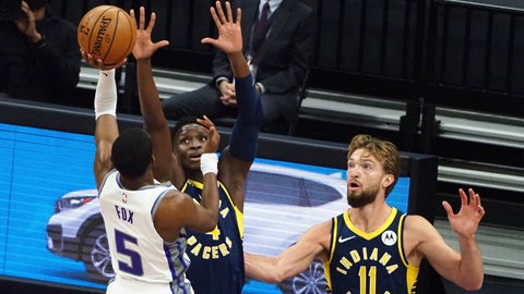 Jan 11, 2021; Sacramento, California, USA; Sacramento Kings guard De'Aaron Fox (5) shoots the ball against Indiana Pacers guard Victor Oladipo (4) during the first quarter at Golden 1 Center. Mandatory Credit: Kelley L Cox-USA TODAY Sports