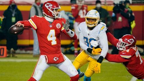 Jan 3, 2021; Kansas City, Missouri, USA; Kansas City Chiefs quarterback Chad Henne (4) throws a pass against the Los Angeles Chargers during the second half at Arrowhead Stadium. Mandatory Credit: Jay Biggerstaff-USA TODAY Sports