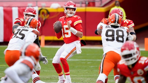 Jan 17, 2021; Kansas City, Missouri, USA; Kansas City Chiefs quarterback Patrick Mahomes (15) drops back to pass against the Cleveland Browns during the first half in the AFC Divisional Round playoff game at Arrowhead Stadium. Mandatory Credit: Jay Biggerstaff-USA TODAY Sports