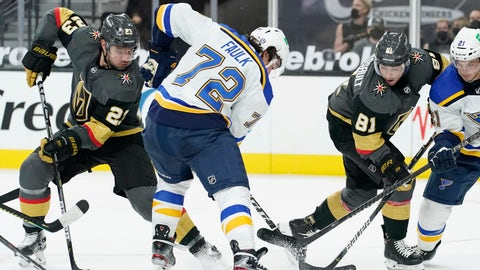 St. Louis Blues defenseman Justin Faulk (72) vies for the puck with Vegas Golden Knights defenseman Alec Martinez (23) and center Jonathan Marchessault (81) during the second period of an NHL hockey game Tuesday, Jan. 26, 2021, in Las Vegas. (AP Photo/John Locher)