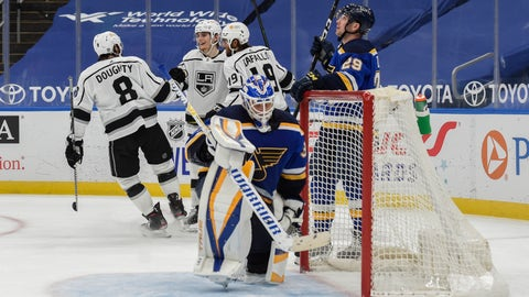 Los Angeles Kings' Lias Andersson (24) is congratulated by teammates after scoring a goal against the St. Louis Blues during the second period of an NHL hockey game Sunday, Jan. 24, 2021, in St. Louis. (AP Photo/Joe Puetz)